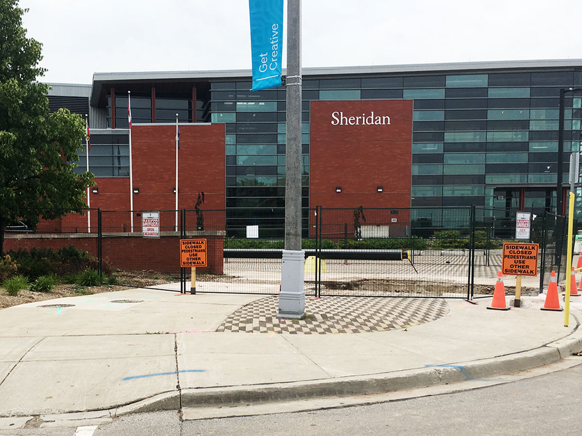 Installation of district heating and cooling system at Sheridan College.